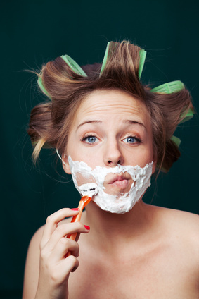 woman-shaving-face