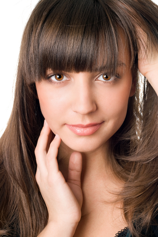 young woman brown hair and eyes