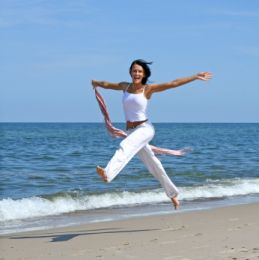 woman-skipping-beach-small