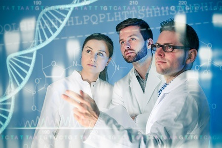 38495347 – group of geneticists working at media screen. genetic engineering