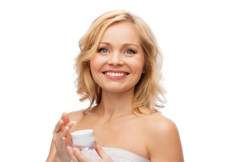 blond-woman-applying-cream