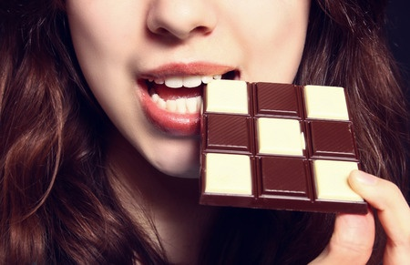 43271048 – closeup of woman eating chocolate