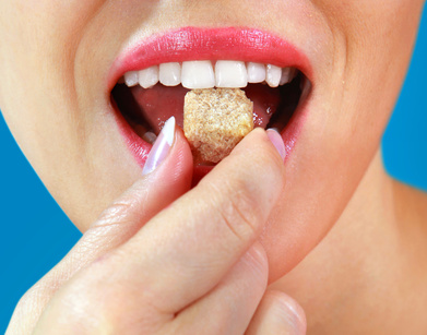 Woman eating sugar