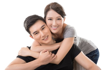 31629594 – attractive young asian couple, closeup portrait on white.