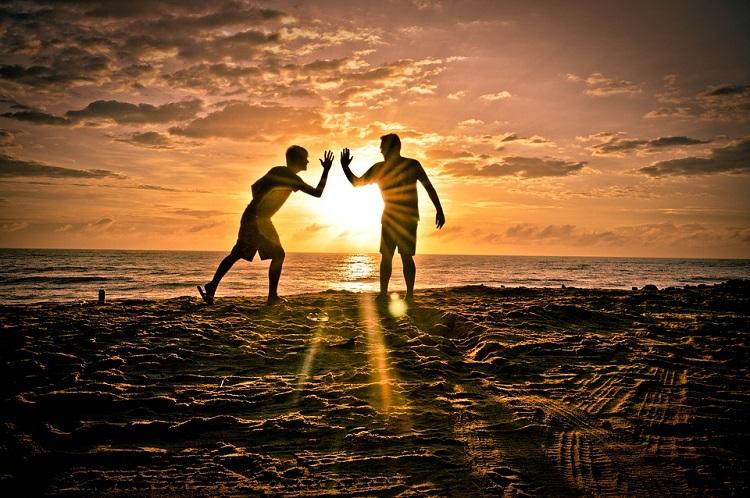 Friends on beach pixabay