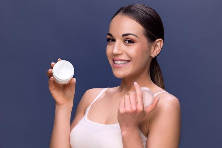 Woman holding cream 2 123rf